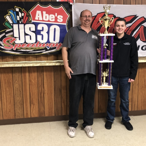 Cade receiving ROY hardware from US 30 track owner Bobby Lincoln.